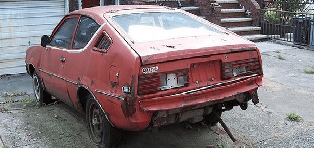 junk car in garrage