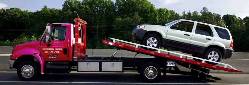 Flatbed towing by The Calgary Towing